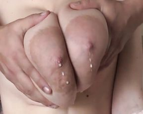 Milking Super Big Boobs from a Brunette