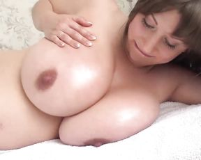 Pregnant Big-Breasted Woman on the Bed