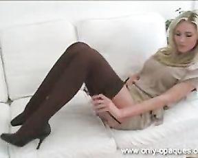 Splendid light-haired in splendid beige minidress with dark-hued undergarments