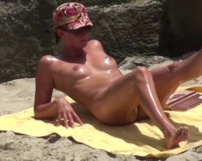 Naked Beach Jaw-Dropping Sunbather Takes off her Disguise to Uncover a Face as Super-Sexy as her Bod