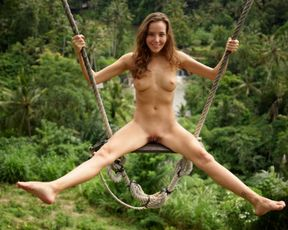 Best Swing in Bali. Explicit Nude girl rolling