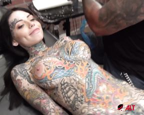 Sexy Tiger Lilly gets a forehead tattoo