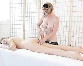 Olive and Veronica are making love with each other in a massage room, once in a while