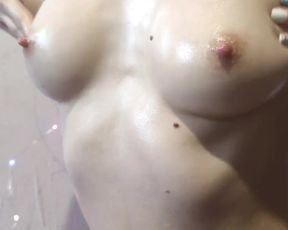 A slender doll paws her mind-blowing baps in grease