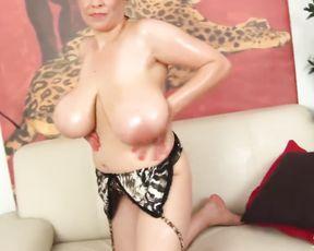 Milf displays her oiled monster breasts